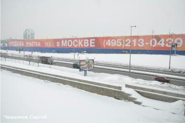 Россия, Санкт-Петербург. Рекламный баннер на месте строительства Охта-центра